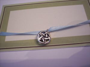 A Tiny Pentacle, Strung on a Ribbon.