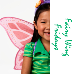 girl with dark hair wearing a green shirt and pink wings