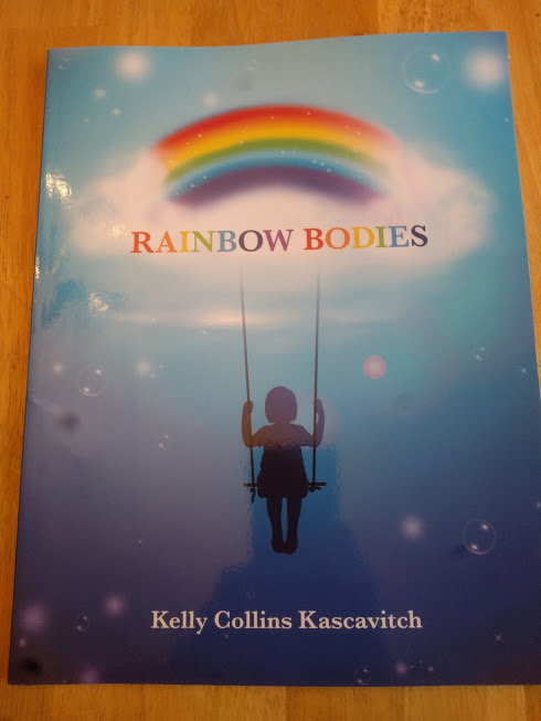 Rainbow Bodies book, blue background with a rainbow at the top and the silhouette of a child on a swing